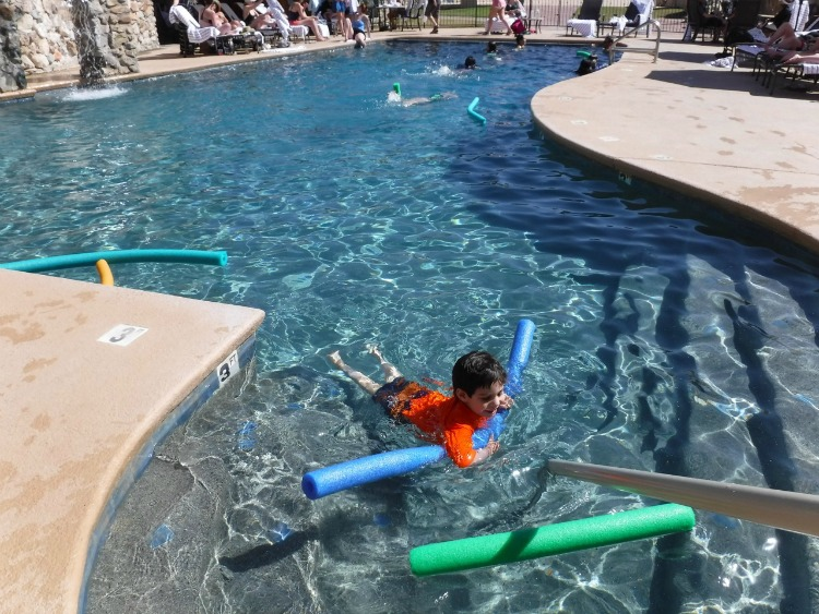 The main pool at the Tanque Verde Ranch is refreshing after spending the day participating in activities. Photo by Multidimensional TravelingMom, Kristi Mehes.