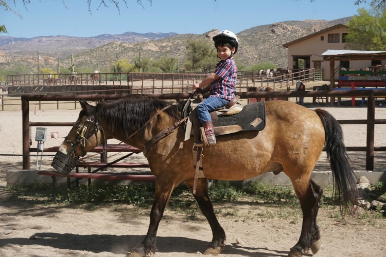 Get ready to saddle up! Horseback riding is one of the reasons that the Tanque Verde Ranch is one of the best dude ranches for young kids. Photo by Multidimensional TravelingMom, Kristi Mehes.