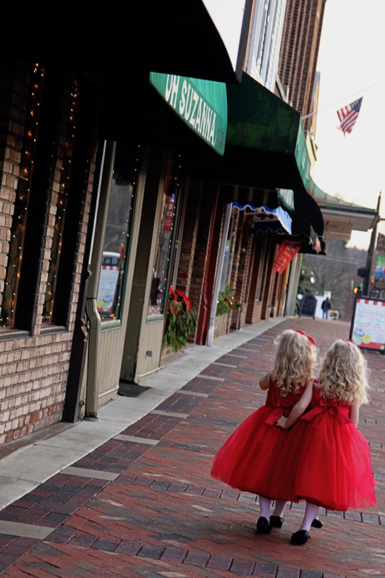 twin girls walk alongside a cobblestone road in Historic Lebanon, Ohio
