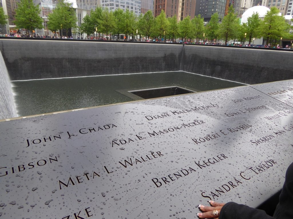 The names of 9/11 victims are on a fountain outside the 9/11 Museum in New York City.