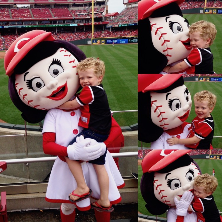Cincinnati Reds mascot Rosie Red poses with a preschool boy during a Reds baseball game in Ohio