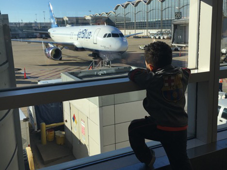 Watching airplanes at the airport can be fun when you travel solo with a toddler!