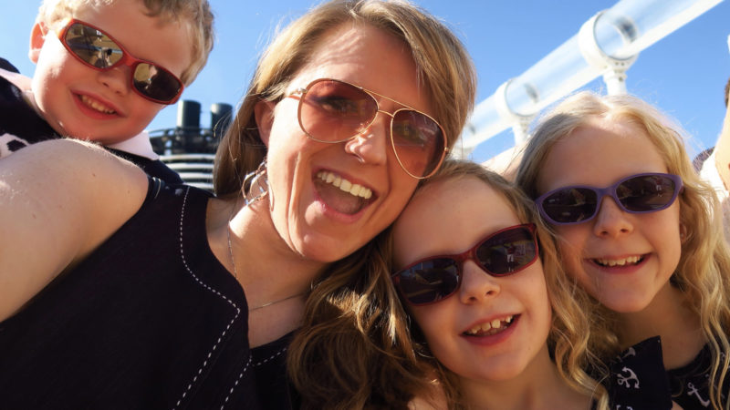 a mom and three kids are excited to sail away on a Transatlantic Cruise aboard the Disney Magic