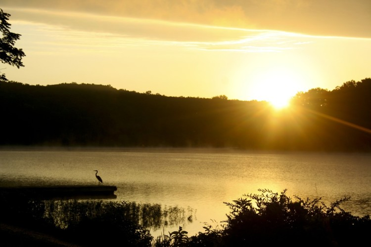 sunset on the lake of the ozarks, a perfect place to spend an evening during a Midwest road trip