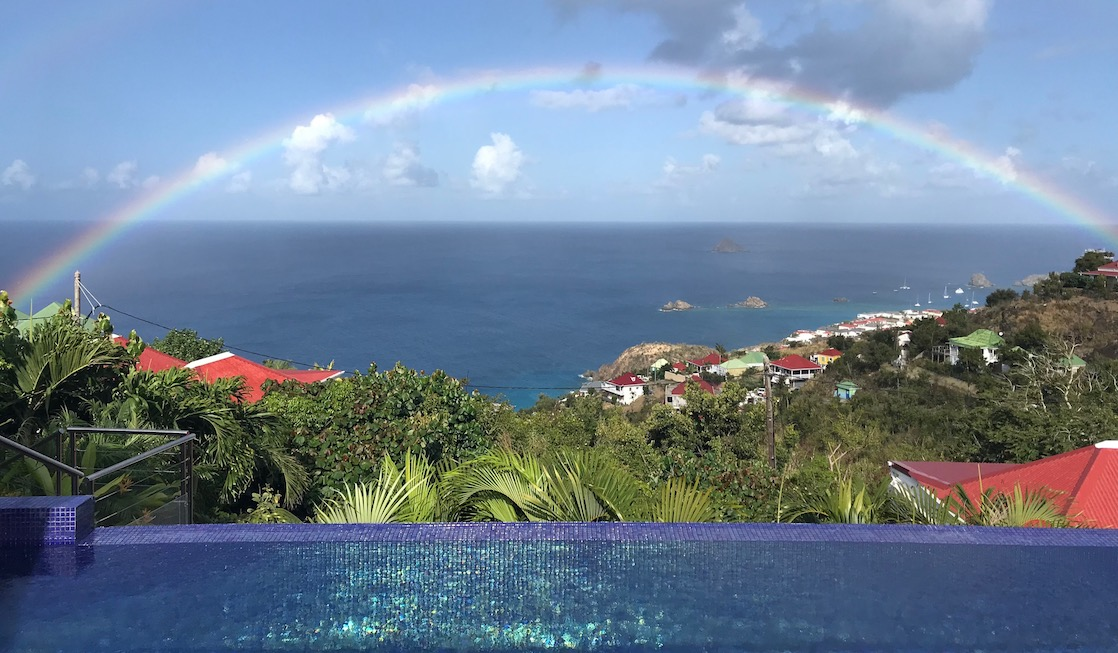 rainbow over ocean and pool in St. Barths after Irma