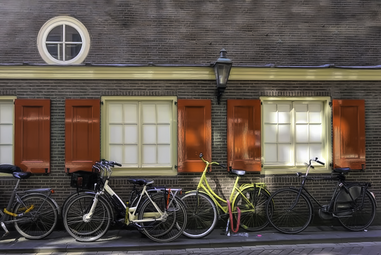 How to visit Amsterdam in two days. Bikes frame the streets of Amsterdam.