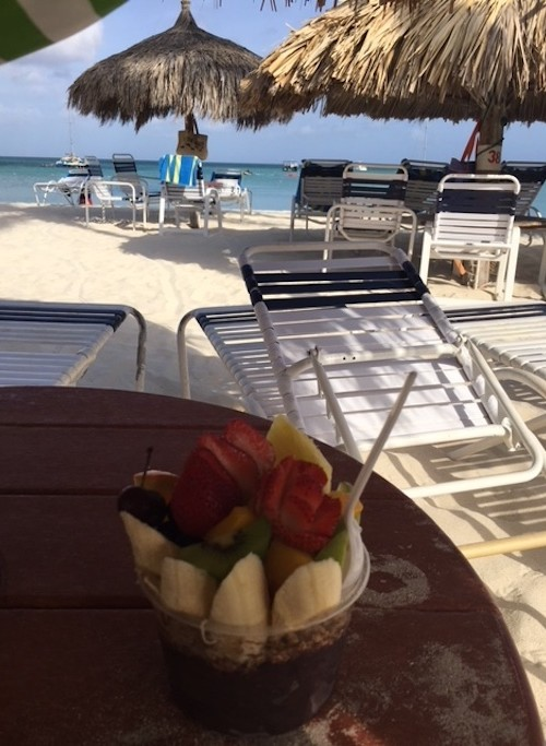 healthy breakfast at the beach, one of many super wellness activities for kids in Aruba