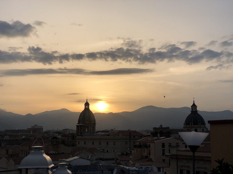 Things to do in Sicily include enjoying sunsets and Sicilian wine from a rooftop in Palermo.