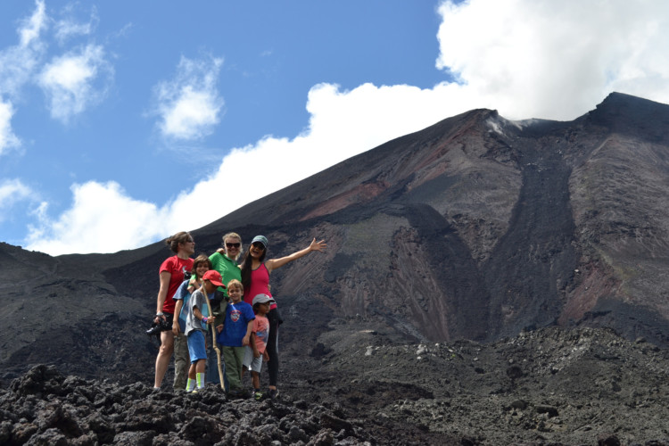 Reaching the top during a hike to Pacaya Volcano is a fun things to do in Guatemala with teens.