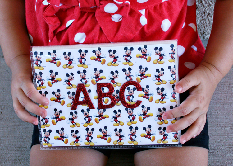 Teach your kids their ABCs the happiest way on earth--with photos taken at Disney World! This easy DIY Disney project will help kids recognize letters and learn to read while also reminding them of the fun they had on their Disney vacation! Would also be a great baby shower gift for a Disney fan!
