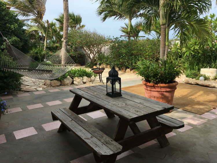 This Airbnb rental in Oranjestad, Aruba comes complete with a beautiful and spacious backyard.