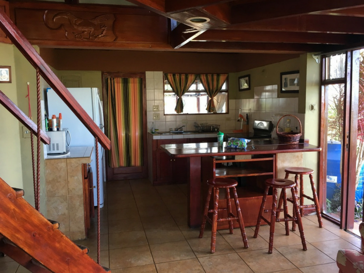 This Airbnb rental in Atenas, Costa Rica offers a full kitchen on the lower level.