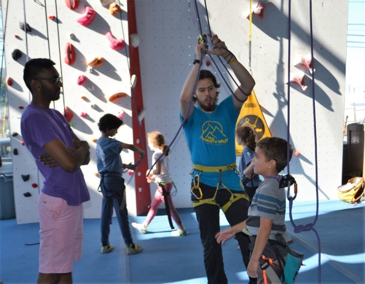 Getting a short safety talk before indoor climbing