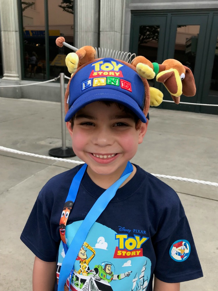If you're shopping in Toy Story Land, you'll be sure to find a slinky dog headband and a Toy Story Land baseball cap. Photo by Multidimensional TravelingMom, Kristi Mehes.