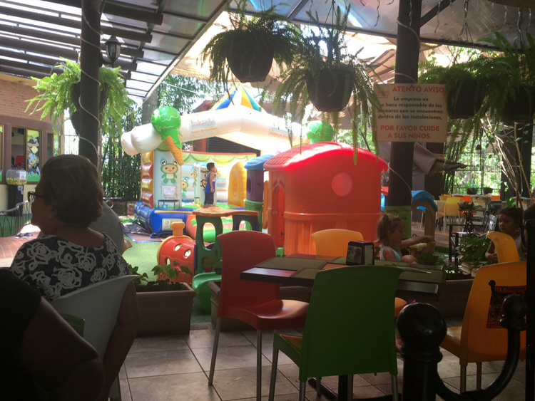 When moving abroad as a single mother, there are several things to consider when deciding on a location.A large indoor playground inside of a restaurant in Puerto Vallarta, Mexico.