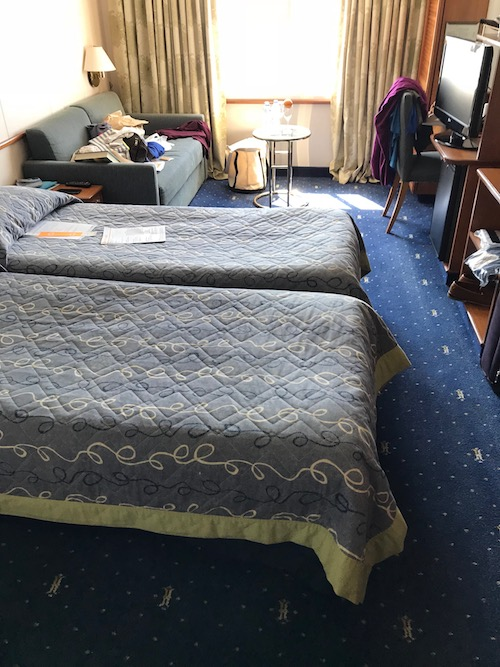 Celestyal cruises stateroom with two beds and plenty of room.