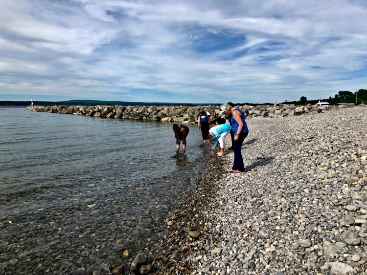 Here we are combing the rocky beaches for collectible Petoskey stones, one of the popular things to do in Northern Michigan.