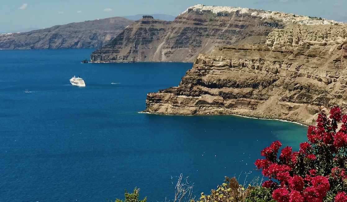 Greek island hopping cruise ship in the Santorini caldera