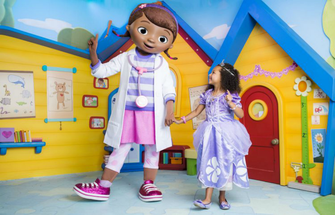 Toddler with Doc McStuffins at Disney World