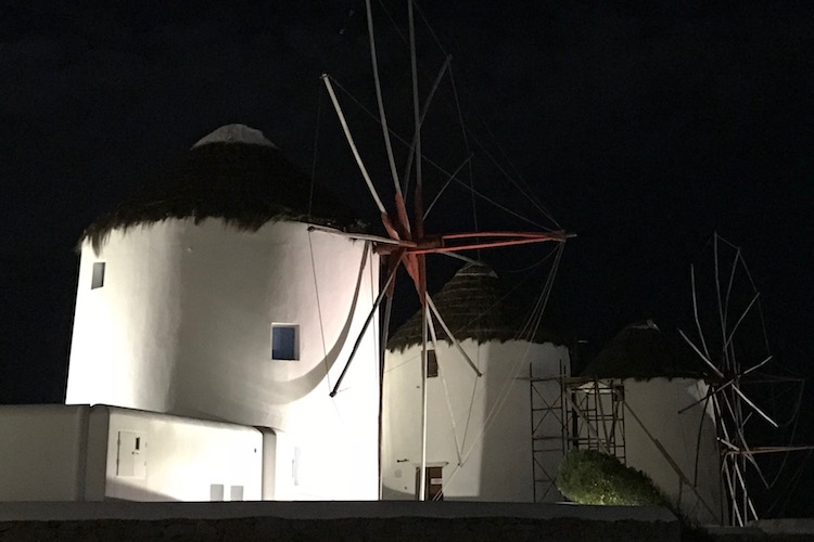 Mykonos windmills at night - a must-see on a greek island hopping cruise aboard celestyal cruises