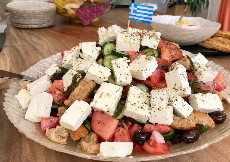 greek salad with feta, olives, and tomatoes served at lunch during a greek island cruise