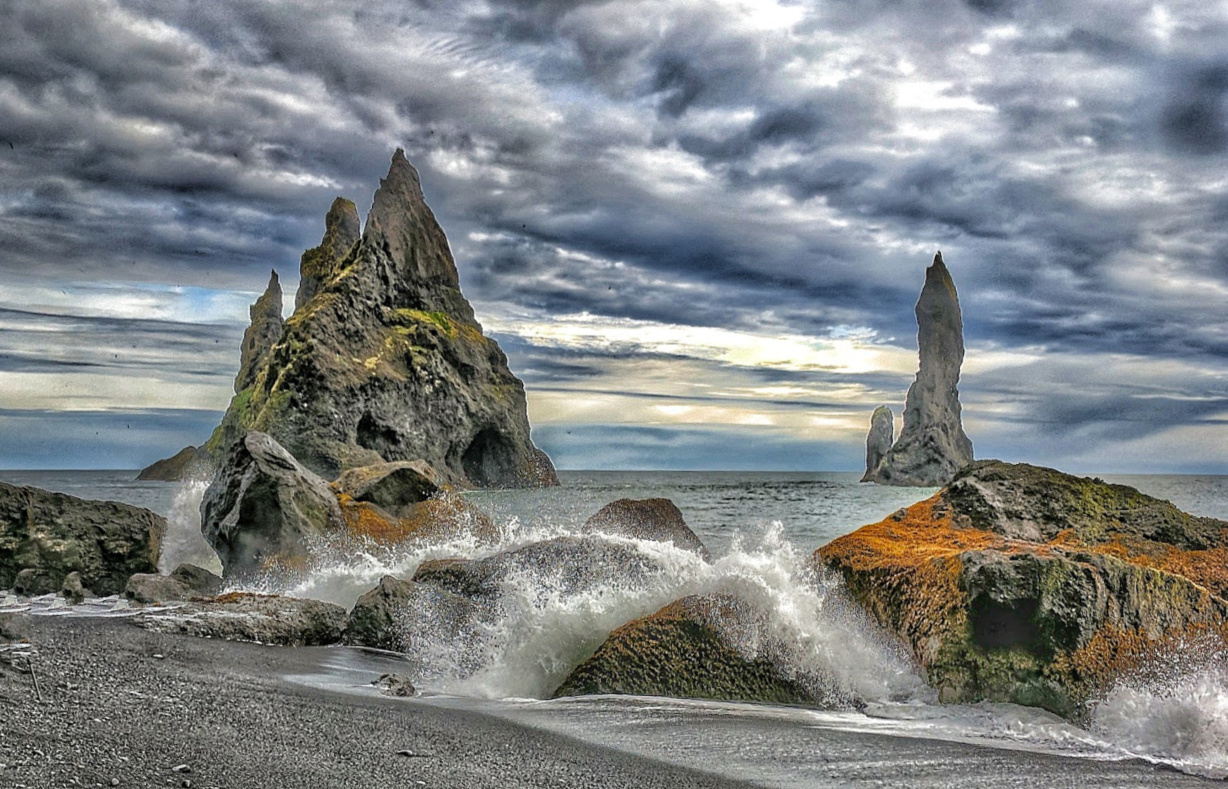 Planning Iceland road trip. Renisfjara black sand beach is a must-see in Iceland.