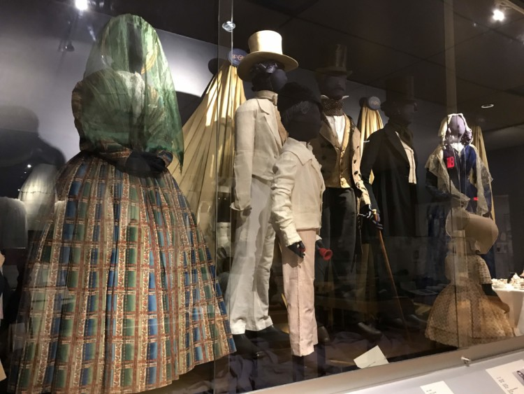 Must-Visit Places on the New York Path Through History Trail: Genessee Country Village & Museum's extensive clothing pieces.