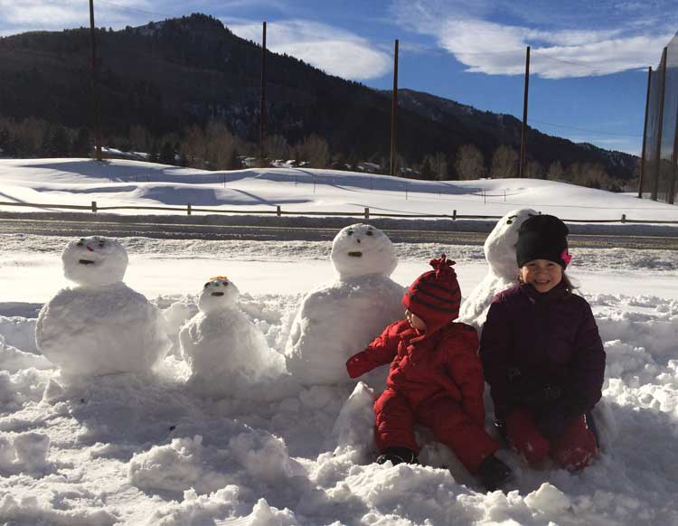 You will want to be prepared to build snowmen on your family ski trip.