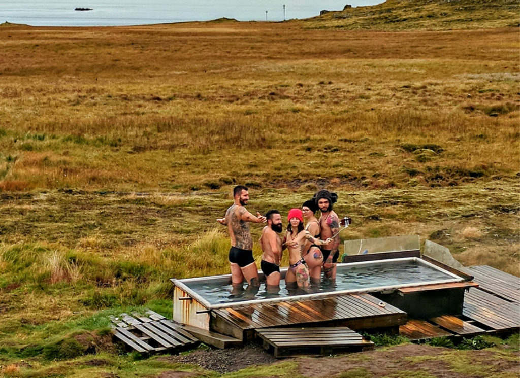 Iceland packing list. People in a hot tub.