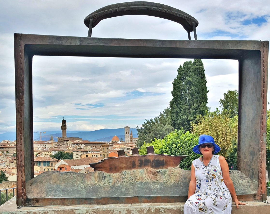 Basics of travel hacking. Rose gardens overlooking Florence.