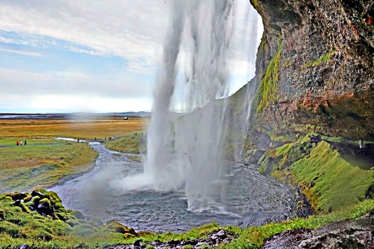 Planning Iceland road trip. Seljalandsfoos falls on The Ring Road invites you to circle it around.