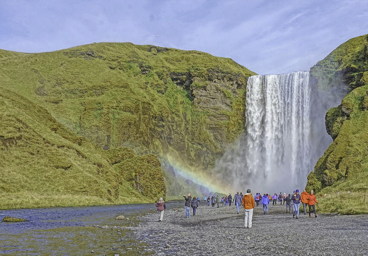 Planning Iceland road trip. Skogafoss waterfall, just like all natural attractions in Iceland, is free to visit.