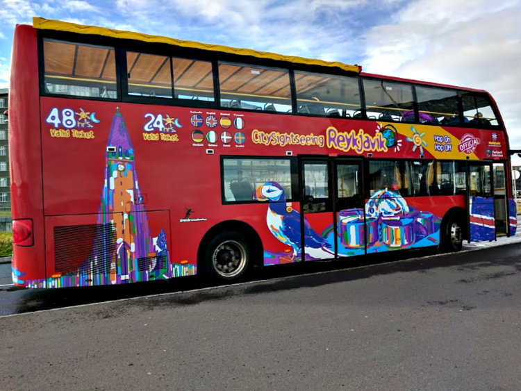Planning Iceland road trip. Colorful sightseeing bus in Reykjavik.