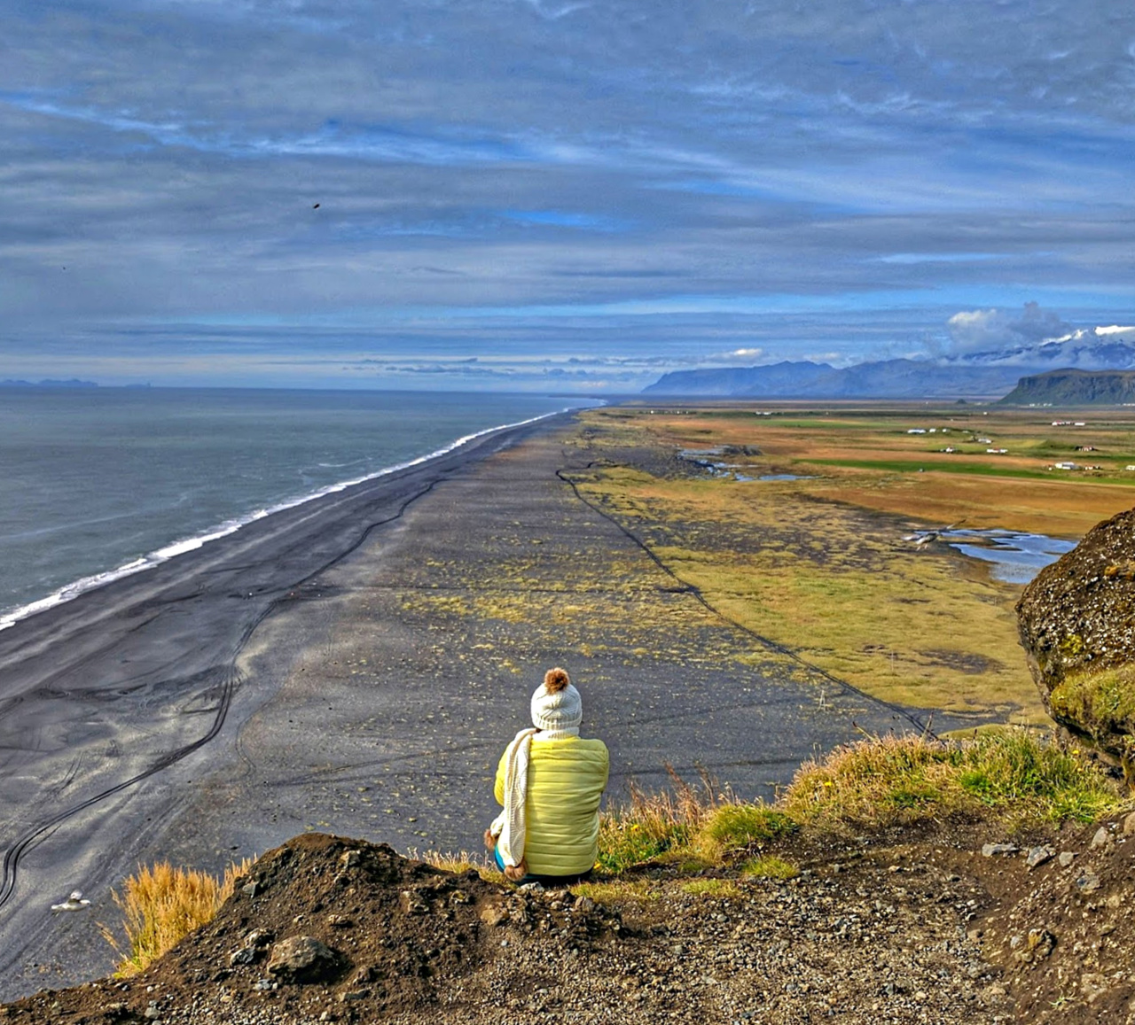 Planning Iceland Road trip. Enjoying vast views of the Black Sand Bbach.