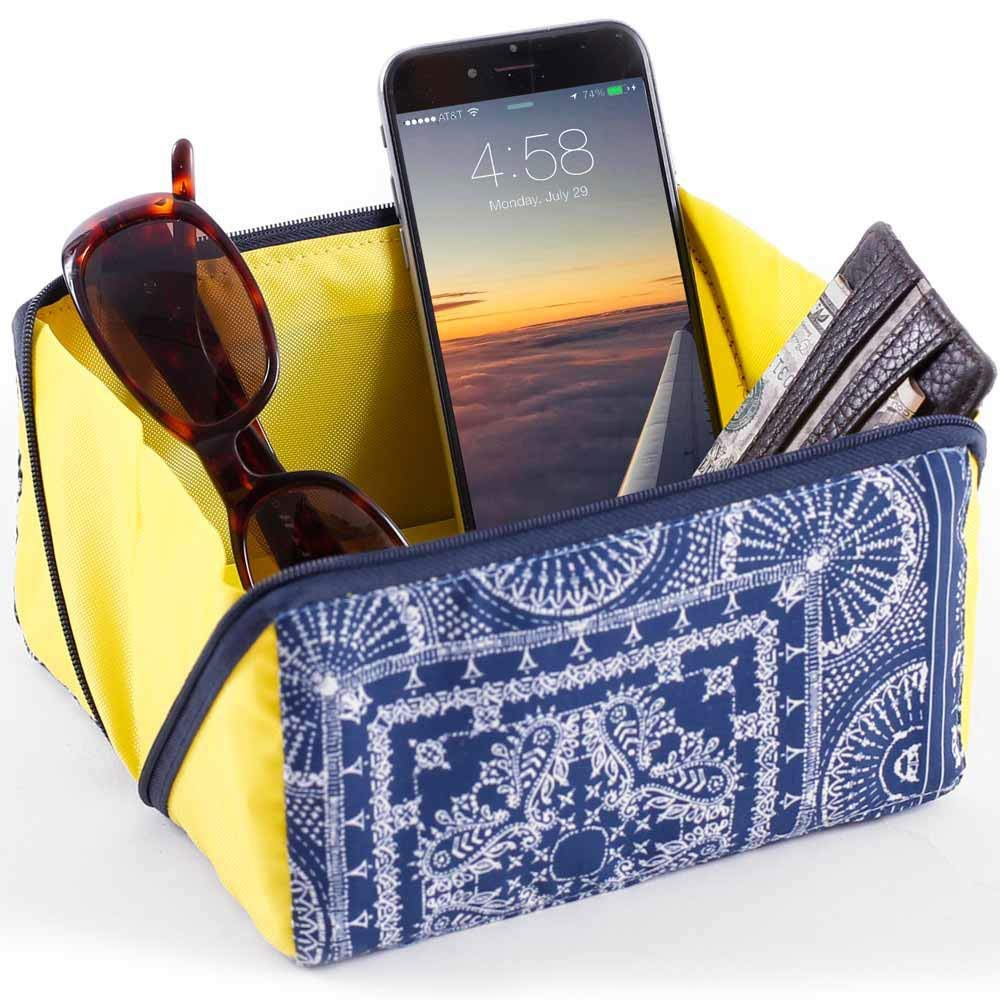 Don't leave a thing behind with this Travel Valet. The bright color will catch your attention but easily zips up to go in a carry-on.| TravelingMom Best Travel Gifts for Women
