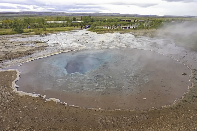 Iceland Planning tips. Geysir - a geothermal attraction with a shooting geyser, boiling pools and streams.