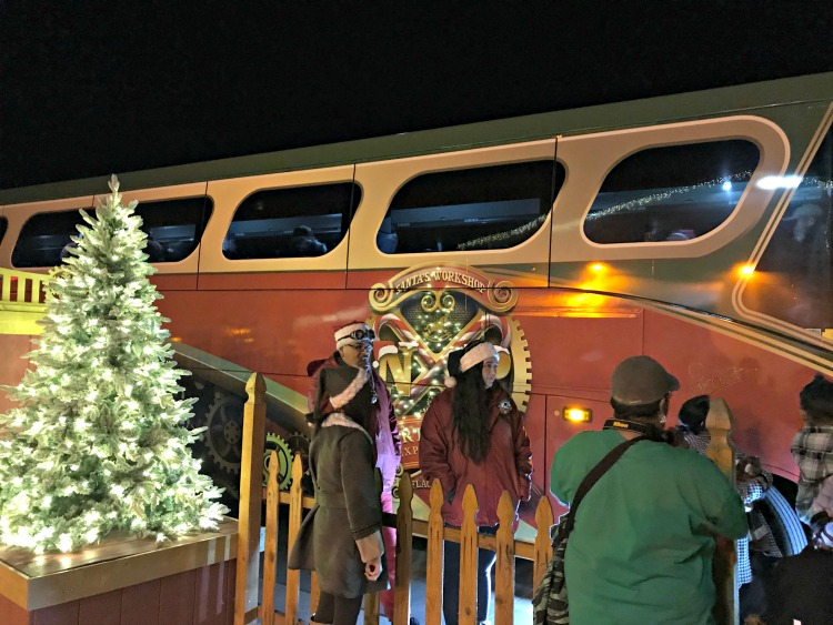 Boarding the North Pole Experience Trolley to Santa's Workshop