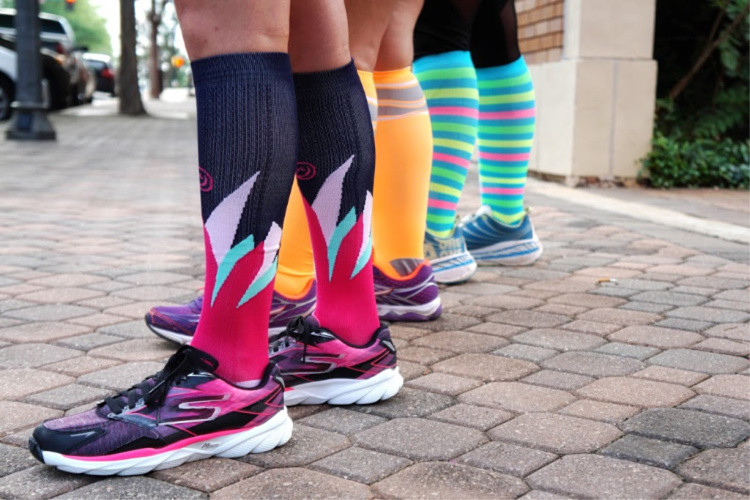 Crazy compression socks are perfect gift for the runner among your female travelers. | TravelingMom Best Travel Gifts for Women