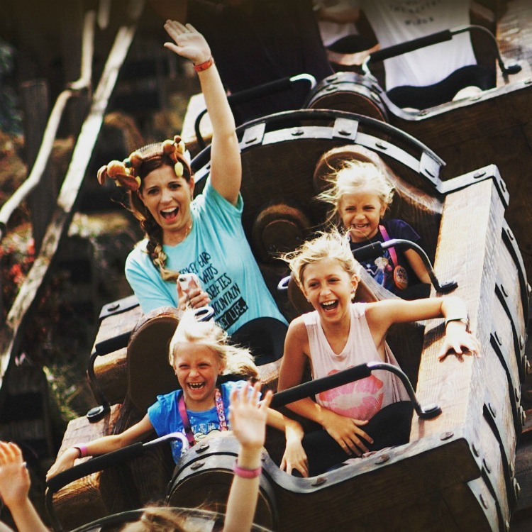 Mom and three daughters on Disney ride captured with Memory Maker - TravelingMom