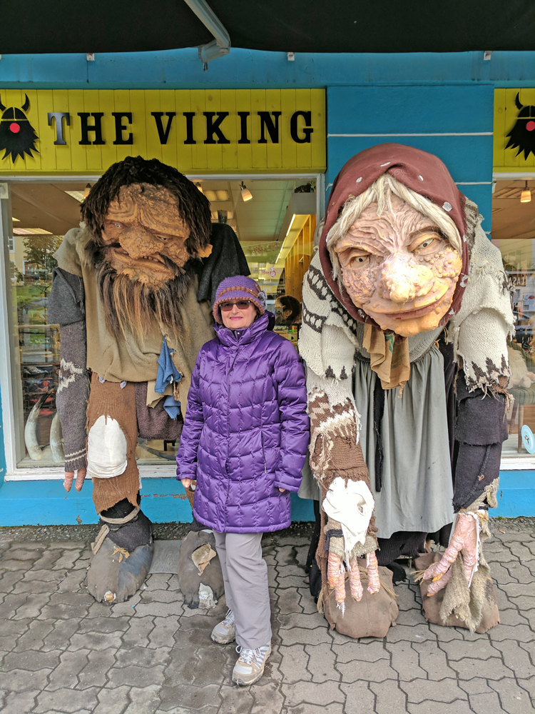 Iceland Weather. Two trolls and a visitor.