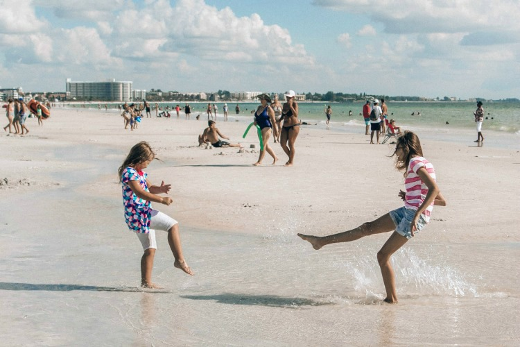 Kids love to play in the tide pools at Siesta Key Beach