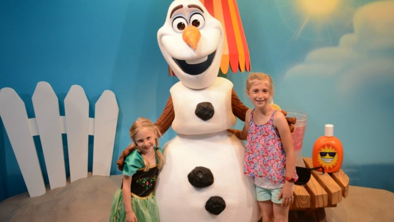 Two girls pose with Olaf at Disney World - TravelingMom