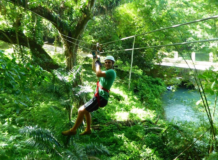 Family ziplining with young adult kids on Jamaica.