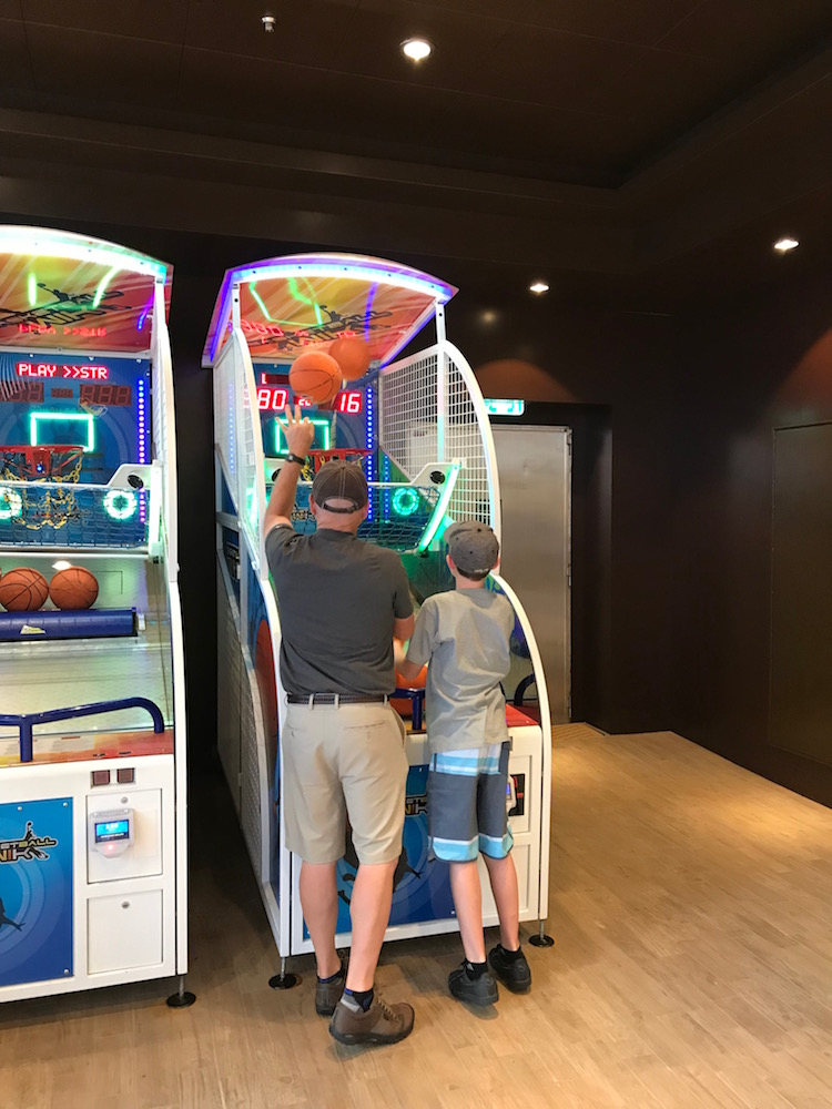 Shooting basketball at the arcade on the Symphony of the Seas scored as a multigenerational cruise favorite