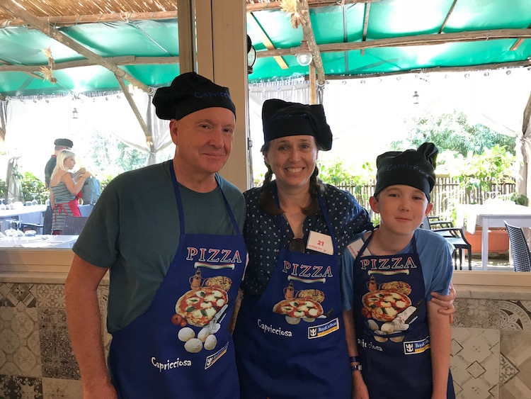 Three generations of pizza makers during Pizza Making for families excursion in Sorento was a multigenerational cruise favorite