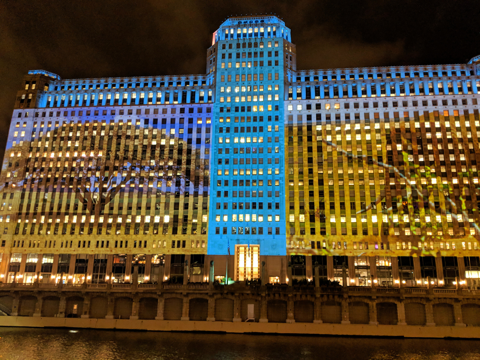 Projected art display lights up the Merchandise Mart facade 5 nights a week.