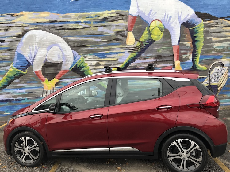 all electric Chevy Bolt in front of a mural in Portland Maine
