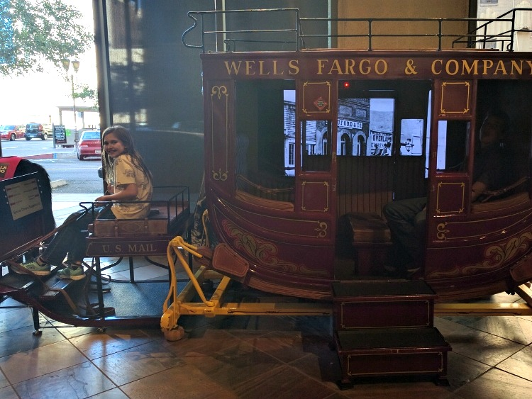 Living history trips with kids in Phoenix: Interactive wagon play at Wells Fargo Museum.