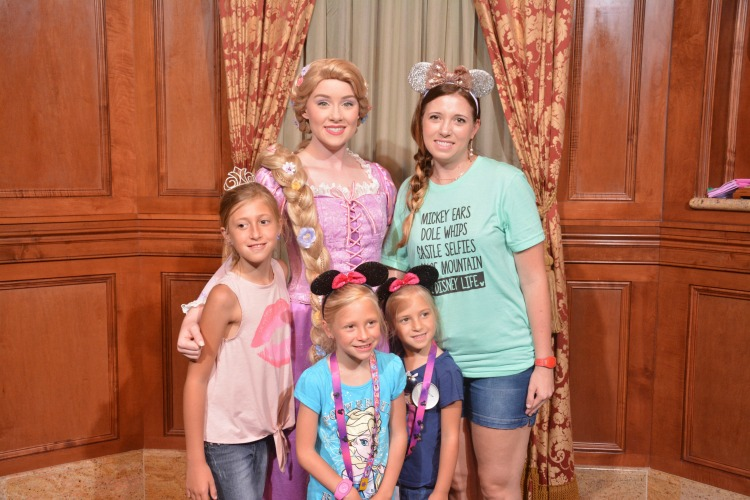 Disney Memory Maker photo of Disney princess, mom and 3 daughters - TravelingMom