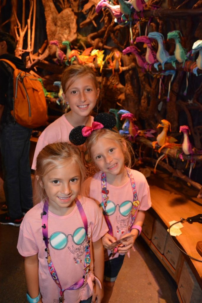 Disney Memory Maker photo of three girls in Disney World - TravelingMom